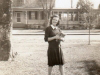 edith-hurff-in-front-yard-with-saunders-house-in-background-img056