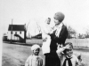 ethel-godwin-holding-daughter-ann-jenny-woodard-and-bernard-godwin-jr-in-front-of-godwin-sawmill-with-gwaltney-store-in-background-circa-1929-img334