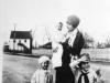 ethel-godwin-holding-daughter-ann-jenny-woodard-and-bernard-godwin-jr-in-front-of-godwin-sawmill-with-gwaltney-store-in-background-circa-1929-img334