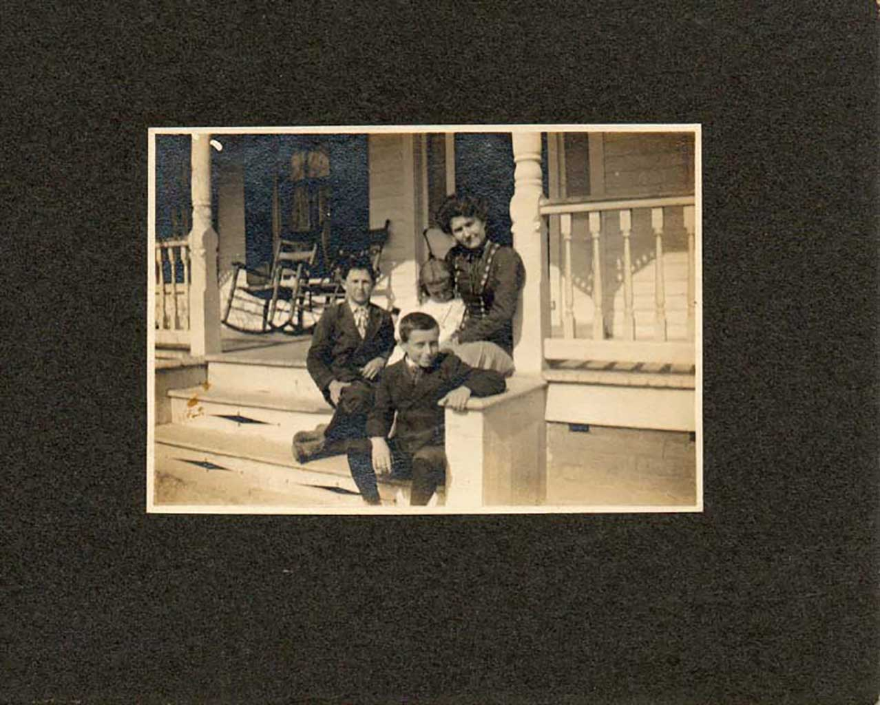 front-porch-of-gilliam-home-with-carlyle-and-madge-holding-mary-gilliam-with-oliver-gilliam-a-cousin-and-ray-img045