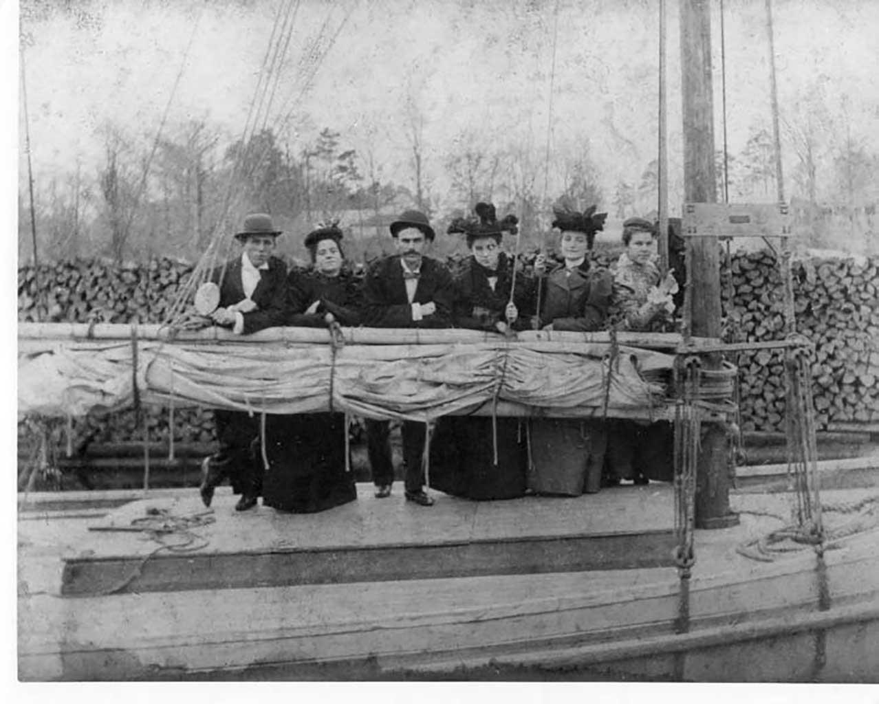 schooner-windrey-in-wester-branch-creek-l-r-claude-susie-gilliam-jim-causey-birdie-crump-manie-cook-teacher-eliz-kirk-brady-1897-img190
